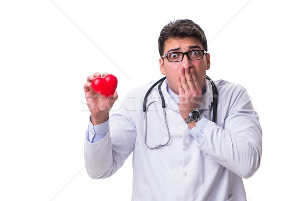 Young male cardiologist doctor holding a heart isolated on white Stock photo © Elnur