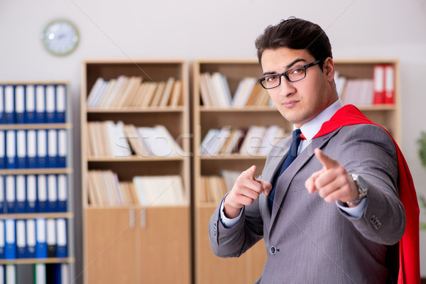Superhero businessman working in the office Stock photo © Elnur
