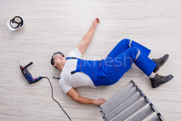 Worker after falling from height - unsafe behavior Stock photo © Elnur
