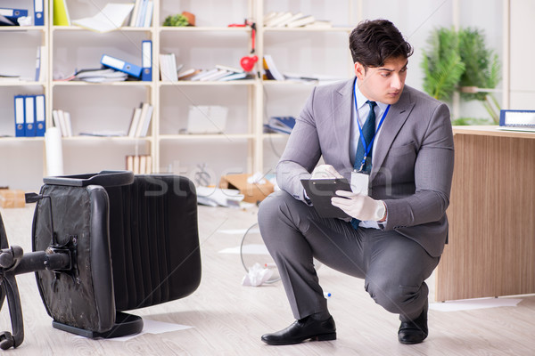 Young man during crime investigation in office Stock photo © Elnur