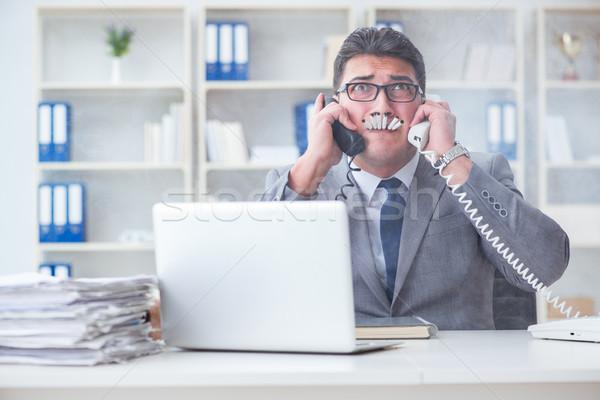 Businessman smoking in office at work Stock photo © Elnur
