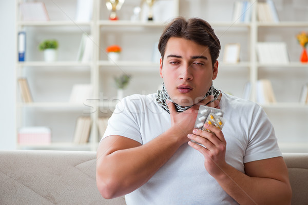 Young man suffering from sore throat Stock photo © Elnur