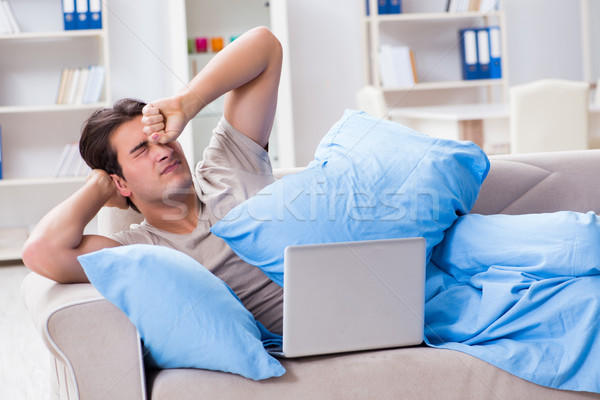 Man working late at his laptop at home Stock photo © Elnur