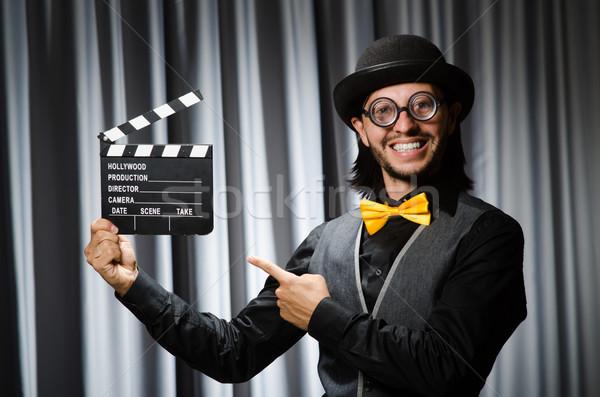 Сток-фото: смешные · человека · фильма · совета · занавес · улыбка
