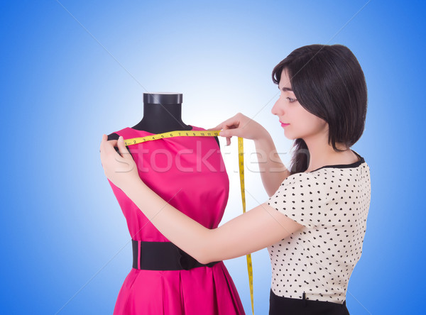 Young tailor isolated on the white Stock photo © Elnur