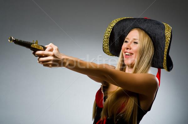 Pirate with gun against grey background Stock photo © Elnur
