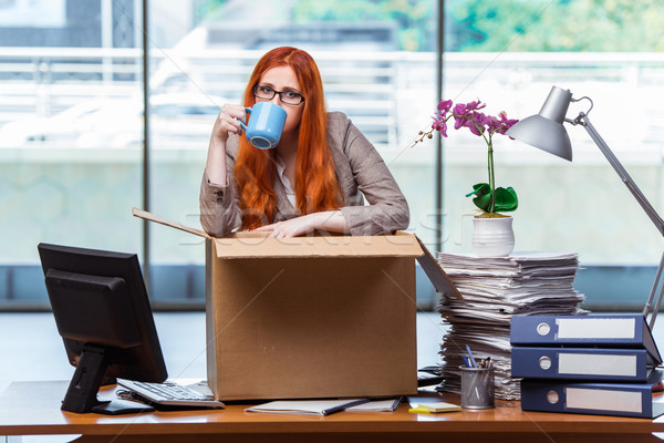 Red head woman moving to new office packing her belongings Stock photo © Elnur