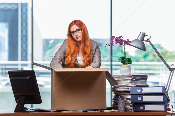 The red head woman moving to new office packing her belongings Stock photo © Elnur