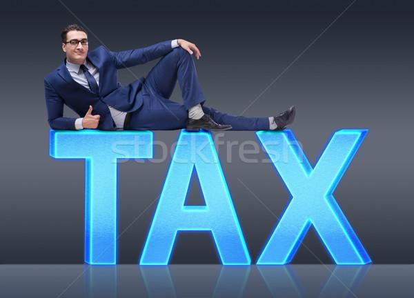 Businessman in tax burden business concept Stock photo © Elnur