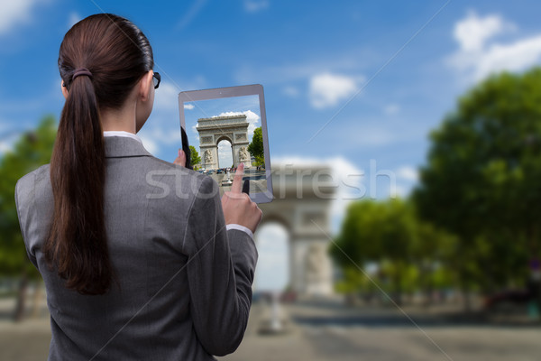 Virtual reality travel concept with woman and tablet Stock photo © Elnur