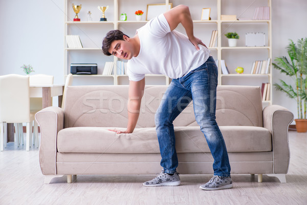 Stock photo: Man suffering from sick stomach and vomiting