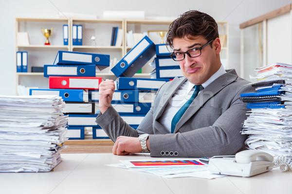 Imprenditore occupato scartoffie ufficio carta uomo Foto d'archivio © Elnur