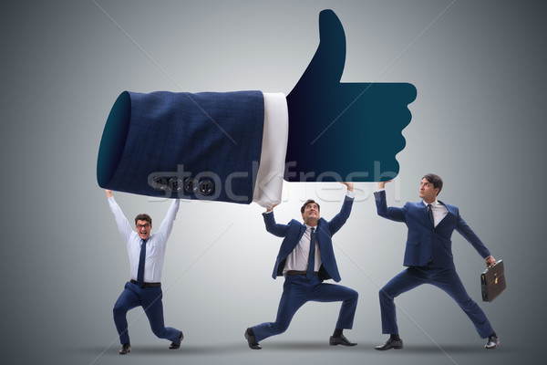 Businessmen supporting thumbs up gesture Stock photo © Elnur