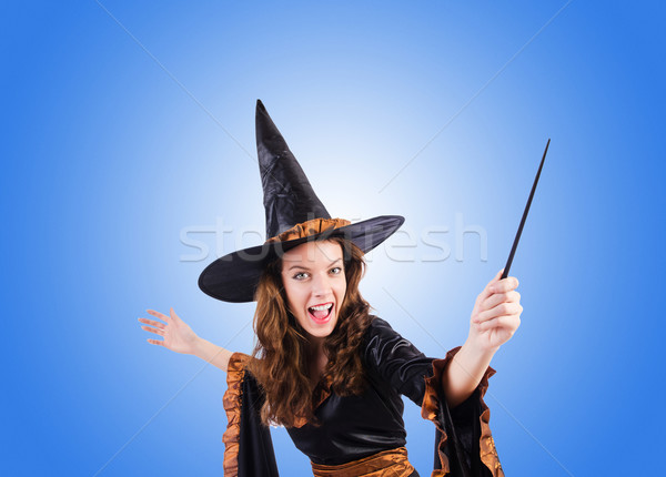 Witch with wand against the gradient  Stock photo © Elnur