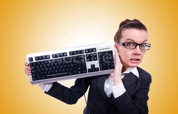 Nerd businessman with computer keyboard against the gradient Stock photo © Elnur