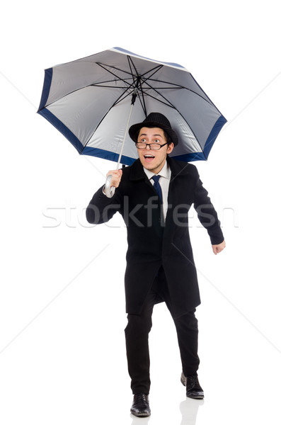 Young man with umbrella isolated on white Stock photo © Elnur