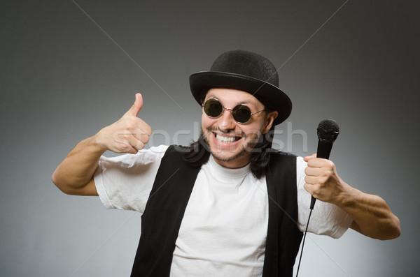 Stock photo: Funny man in karaoke club