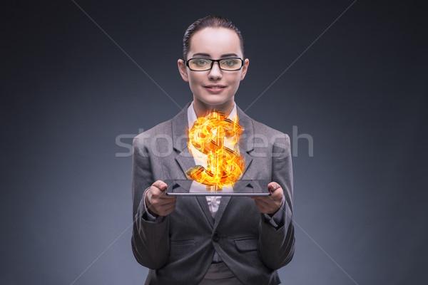 Femme d'affaires brûlant signe du dollar argent Photo stock © Elnur