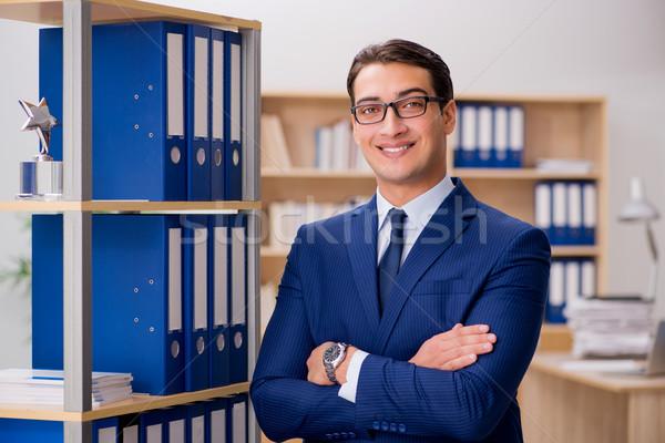 Jóképű üzletember áll polc iroda öltöny Stock fotó © Elnur