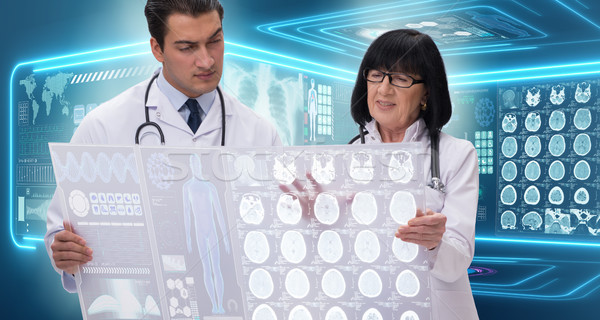 The woman and man doctor looking at mri scan image Stock photo © Elnur