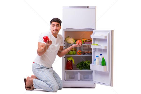 Człowiek lodówka pełny żywności domu owoców Zdjęcia stock © Elnur