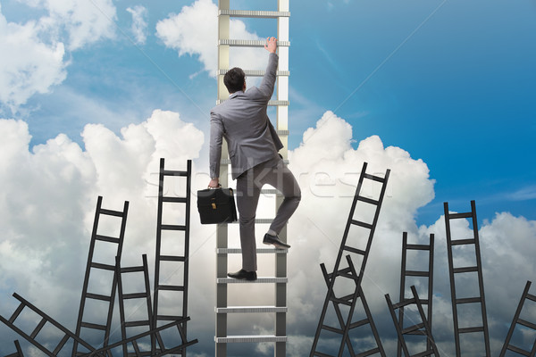 Career concept with businessman climbing ladder Stock photo © Elnur