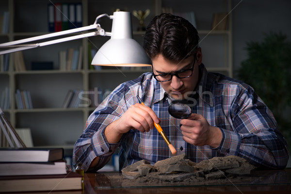 The archeologist working late night in office Stock photo © Elnur