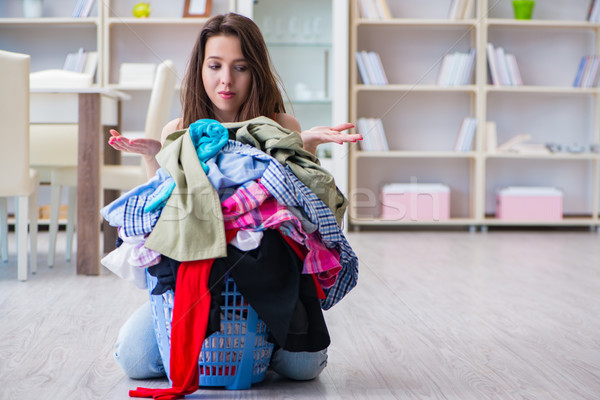 The stressed woman doing laundry at home Stock photo © Elnur
