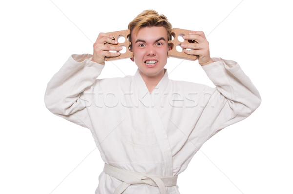Funny karate man breaking bricks isolated on white Stock photo © Elnur