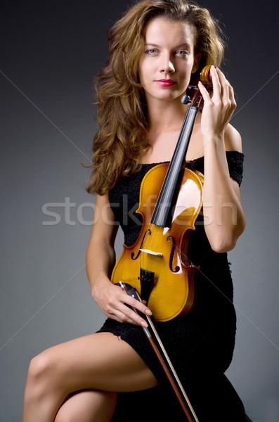 Női musical játékos sötét nő koncert Stock fotó © Elnur