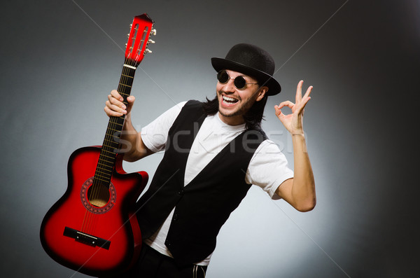 Man wearing sunglasses and playing guitar Stock photo © Elnur