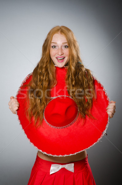Nice woman wearing red sombrero hat Stock photo © Elnur