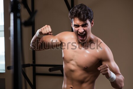 Muscular man with baseball bat Stock photo © Elnur