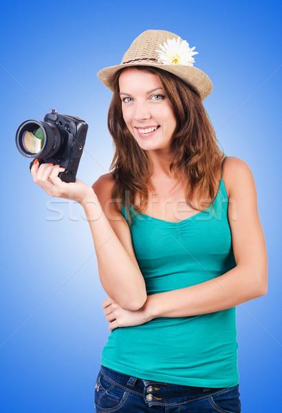 Attractive female photographer on white Stock photo © Elnur