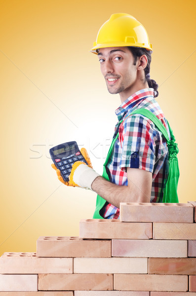 Expensive construction concept with builder and calculator Stock photo © Elnur