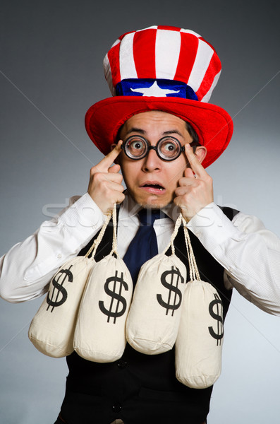 Man with dollar money sacks Stock photo © Elnur