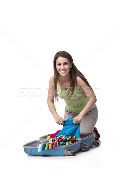 Stock photo: Woman packing preparing for summer vacation isolated on white