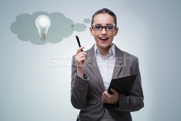 Young woman in bright idea concept Stock photo © Elnur