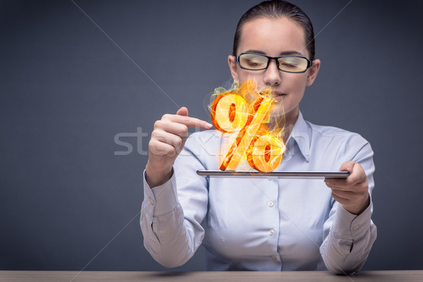 Businesswoman with percent sign in high interest concept Stock photo © Elnur