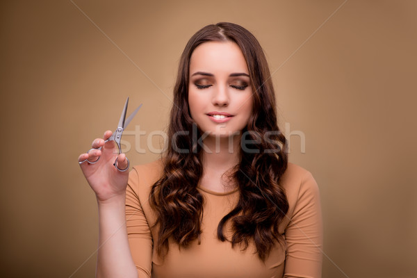Beautiful woman with scissors cutting her hair Stock photo © Elnur