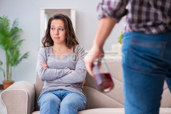Domestic violence concept in a family argument with drunk alcoho Stock photo © Elnur