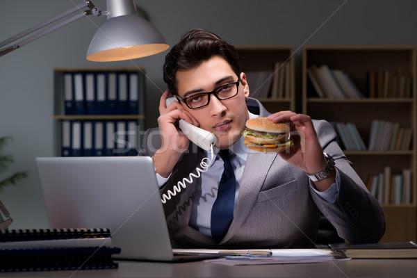 üzletember késő éjszaka eszik hamburger üzlet Stock fotó © Elnur