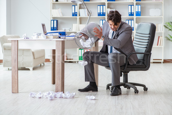 Angry businessman shocked working in the office fired sacked Stock photo © Elnur