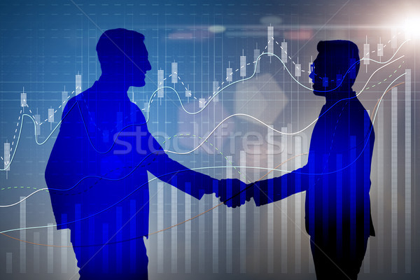 Stock photo: Business cooperation concept with businessmen hand shaking