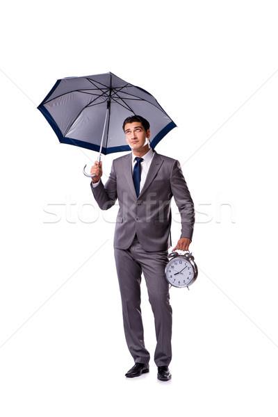 Businessman with umbrella isolated on white background Stock photo © Elnur