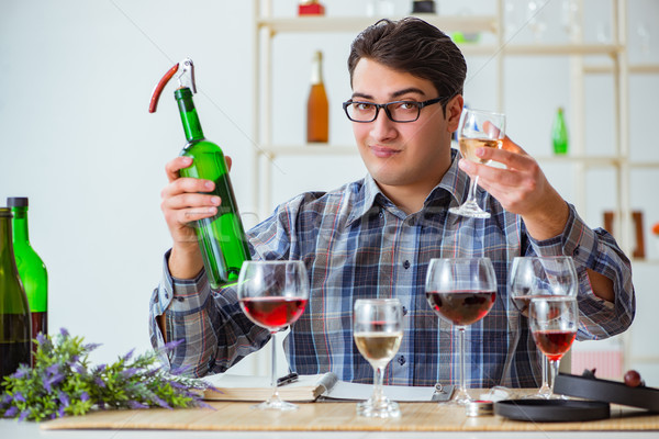 Professional sommelier tasting red wine  Stock photo © Elnur