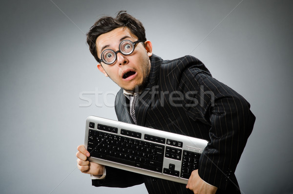 Stock photo: Comouter geek with computer keyboard