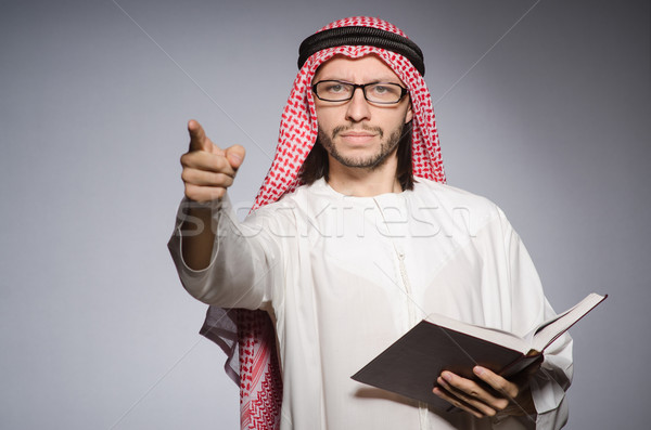 Arab man pressing virtual button Stock photo © Elnur
