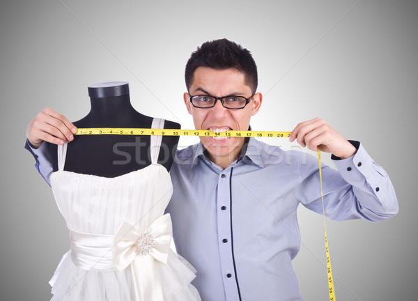 Funny male tailor on white Stock photo © Elnur