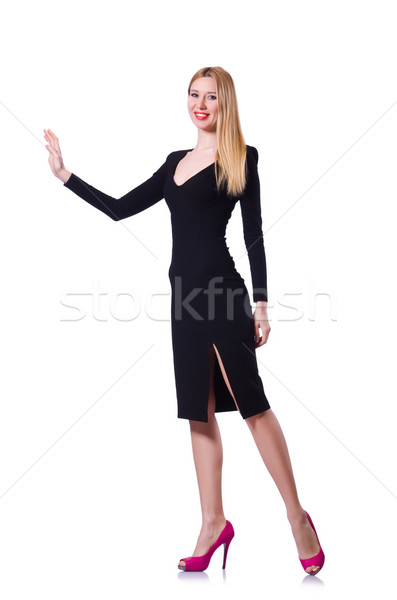 Young girl in black dress pushing isolated on white Stock photo © Elnur